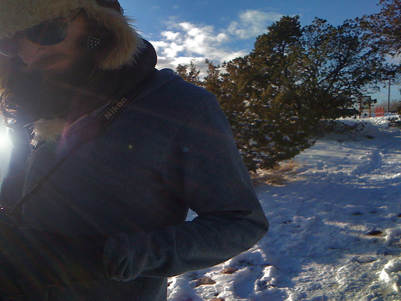 This is my brother Steven walking on one of Santa Fe's lovely public trails, in front of the low-lying sun, along the Santa Fe Trail route.